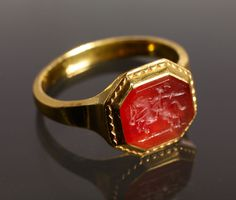 A 22 carat gold ring with a 17th-century German intaglio featuring a rider with a sword. The ring is dated 1735 and bears the hallmark of Amsterdam and the master's mark of Jacob Mense.