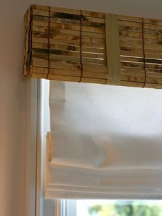 Interesting window treatment- Woven wood blinds as a valance; roman shade gives uniform, white appearance from the street Woven Shades, Bamboo Shades, Bamboo Blinds, Wood Blinds, Wood Valance, Window Curtains, British Colonial Decor, Window Treatments Living Room, Faux Bamboo