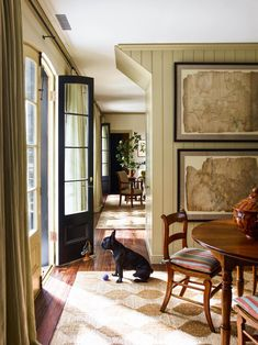 A Restored Carriage House in the Heart of Charleston, South Carolina - Love the art in the dining room
