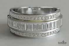 Custom Fine Jewellery Design New Zealand Step shank channel set baguette diamond wedding ring with bead set round diamonds along the outside rims