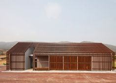 OUJAE Architects designs visitor centre with a serrated roof