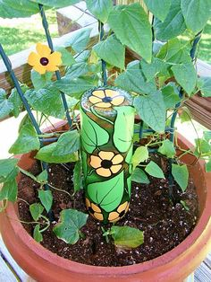 For Mom's Day, make this Recycled Wine Bottle Plant Waterer. It's a great way to recycle and to make watering your potted plants easier. This Recycled Wine Bottle Plant Waterer is a great way to recycle and to make watering your potted plants easier. Recycled Wine Bottles, Wine Bottle Art, Diy Bottle, Wine Bottle Crafts, Bottle Plant, Bottle Garden, Art From Recycled Materials, Plants In Bottles, Water Plants