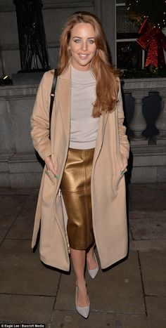 Upping her fashion game: The boutique owner picked out a muted palette of camel colours an...