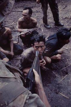 Suspected Viet Cong sit and await their fate. -Vietnam War
