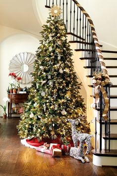 Wrap your staircase banister in ribbon rather than live garland -- it's easier on pets and on your bank account.