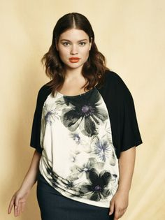 Plus size model Tara Lynn wearing a floral print top with a pencil skirt. Available at Addition Elle, your plus size destination. #plussize