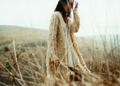 The muted tones of her sweater and the grass... I want to go wherever this picture was taken,