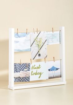 Your decor charms with a cool aesthetic, so show off your equally unique memories within this twine-and-clips photo holder! Complete with nine tiny clothespins from which to hang your snapshots, ticket stubs, and more, this tabletop display will keep fond memories dancing through your thoughts.