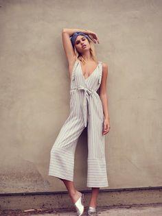 Yarn Dye Stripe Overalls   Yarn dyed lightweight and soft cotton overalls featured in a stripe pattern. * Surplice V-neckline * Waist tie * Adjustable straps * Four-pocket style * Wide legs