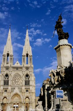 Statues and ornate exterior of Les Reformes Cathedral, Marseille, France.