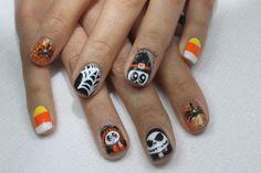 Halloween gel nails. I like the contrasts.
