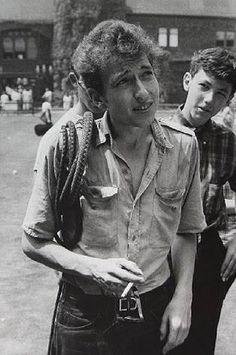 Bob Dylan with his bullwhip, Newport Folk Festival, 1963. Photo by Rowland…