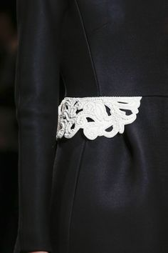 Chic coat with ornate trim embellished with dainty white beads; monochrome fashion details // Valentino