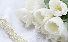 I have always been drawn to white tulips as my favorite flower.I think they look so pure and delicate.