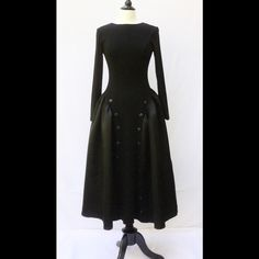 """New Black Vintage Style Gothic Midi Dress M New Black Vintage Style Midi Dress. Size M Measured flat: underarm to underarm: 33-37"""" Waist: 28-34"""" Length: 51"""" Sleeve: 23"""" Scoop neck, v-back. Princess seamed bodice, matte buttons down the front, flared side panels. Polyester, woven knit with polyester sateen panels. Machine wash. Dresses Midi"""