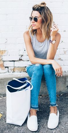 We think that these white slip ons go especially well with skinny jeans - just pair them with frayed ends and a grey tank! Via Christine Andrew Shops: Not Specified