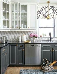 Beautiful kitchen Grey and white gold accent herring bone back splash