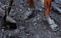 24 hours:  Jammu, India: A labourer works at a coal depot