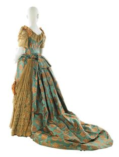 Worth evening dress, back view, 1884.  From MCNY Museum of the City of New York, USA,  Fripperies and Fobs.