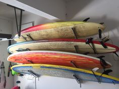 a 4 board surf rack for your entire quiver in your garage #surfboardstorage #surfing #garagestorage #storeyourboard