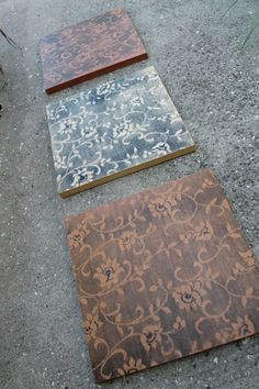 Tape a large piece of lace over a painted wood block, then spray paint or stencil brush another color by themselves or with decoupage graphics