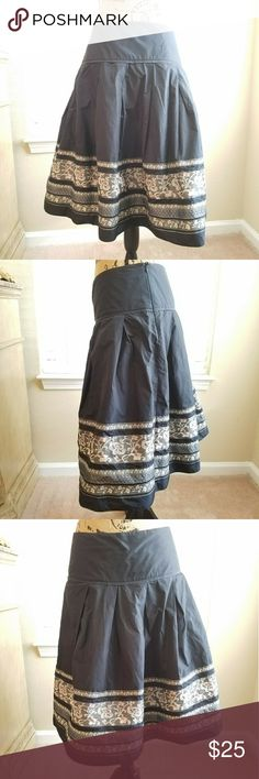 🍍BGN tea length embroidered full circle skirt BGN tea length embroidered full circle skirt. Shiny black fabric with embroidered pink and silver floral hem. Excellent condition! BGN STUDIO Skirts Asymmetrical