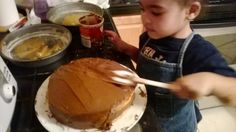 Icing a Cake (For Daddy's Birthday). Let them help make a cake and then let them decorate it too. Clump it on and let them spread it out.