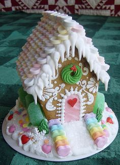 Gingerbread house with cute dripping icicles. #Christmas #food #gingerbread