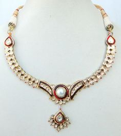 Vintage necklace from South India, gold, diamonds, enamel and pearl.
