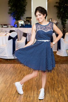 She can definitely dance all night in this polka dot party dress and white Chucks! #danceallnight #polkadots #navy