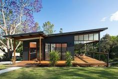"Modern Tropical Home is a Granny Flat for a Hip Elderly Couple Samford Valley Small House - ""Granny Flat"" my ass, I would fight my granny for this house!Samford Valley Small House - ""Granny Flat"" my ass, I would fight my granny for this house! Modern Small House Design, Small Modern Home, Small Modern House Exterior, Flat House Design, Modern Homes, Modern House Exteriors, Modern Roof Design, Modern Cabins, Small Cabins"