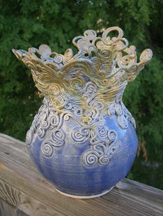 Roadside Art - coil vase - the base thrown on the potter's wheel and each coil added individually forming the top