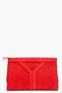 yves saint-laurent. snake suede y clutch in red.