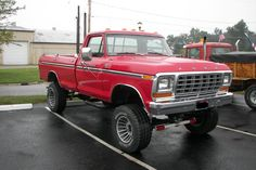 Vintage really nice red lifted Ford truck