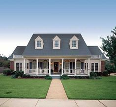 Love this home and porch. I can picture sitting on the front porch with family.