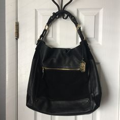 """AUTHENTIC Vince Camuto Mikey Hobo PRICE IS FIRM. I'm having a hard time selling this beautiful purse but I really need some new cookware more than I need this gorgeous handbag. Authentic Vince Camuto, only used a few times. In excellent condition. The only flaw is a tiny bit of a glue """"stain"""" along the left bottom seam of the suede section (see photo). It's barely noticeable. Pebbled leather and rich suede...this bag just smells rich! Vince Camuto Bags Hobos"""