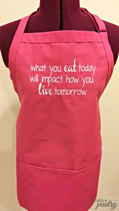 "Just what you need to keep you on track with your goals and healthy eating! Never forget your healthy eating with this ""What You Eat Today will Impact How you Live Tomorrow"" adorable, short and sassy, embroidered apron. Use it for your Sunday Food Prep or when making your favorite ""eat clean"" or ""cheat clean"" dessert by TheCreativePantry, $30. #apron #kitchen #fitness #cleaneating #motivation #exercise #gift #fitnessgift #giftforher #foodprep #SundayFoodPrep"