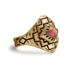 Four Winds Ring | Gold / Coral | A Coral stone cabochon set in Oxidized Brass. Features Carved, Oxidized, Geometric Pattern around band.  Ring measures 17 x 24 x 20 mm. Stone measures 5 x 5 mm. Satin finish.