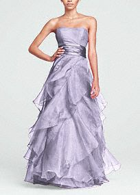The perfect complement to a glamorous bride, this enchanting organza ball gown has it all!  Strapless empirebodice features ruched waist that flatters any figure.  Tiered organza A- Lineskirt is utterly romantic.  Ball gown silhouette is dramatic and slimming.  Fully lined. Back zip. Dry clean only. in the color of watermelon.