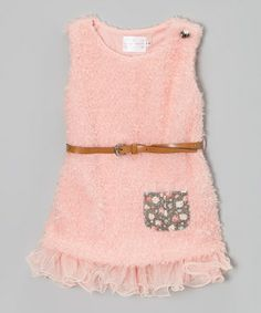 This textured number is perfected for all-day frolicking. With a frilly skirted bottom, belted waist and convenient front pocket, the fancy frock combines little lady practicality with adorable styling during playtime and beyond.
