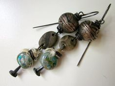 Bits of Wreckage - primitive assemblage nail studded teal gray lampwork glass, fossil beach pebbles, silver kuchi bead,  ox copper earrings by LoveRoot, $58.00