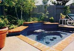 Poolandspa.com - Cool Spa Picture - Inground with Waterfall