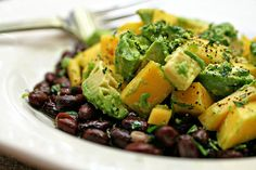 """Mango-Avocado Salad with Black Beans and Lime Vinaigrette  adapted from Whole Foods . serves 4    2 ripe avocados, peeled and cut into 1/2"""" cubes3 T lime juice1 ripe mango, peeled and cut into 1/2"""" cubes1 jalapeño, seeded and minced1 t grated lime zest1/2 t salt1/4 t sugar (or agave nectar)2 T chopped cilantro, plus more for garnish4 T olive oil1 15.5-oz can black beans, drained and rinsedblack pepper, to taste"""