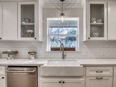 Traditional Kitchen with Crown molding, High ceiling, Flat panel cabinets, Pendant Light, Glass panel, Simple marble counters