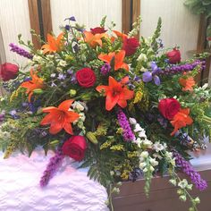 Half casket spray with vibrant flowers
