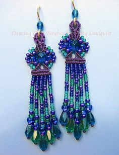 These fringy earrings are not overly long, just enough to swing but not touch the shoulders. I made them on dark purple thread, and used a myriad of jewel tones throughout the fringe in teal, capri blue, metallic purple, and sapphire blue. They have sterling silver ear wires with matching sea blue beads and come with rubber stoppers. The faceted tear drops at the bottom add swing and flash while you wear them.  The last photo is for your reference, to show you how this style looks when worn…