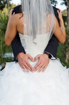 I need a picture like this. Shows the back of the dress and my hair and I love the heart with his hands