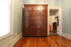 Our customer chose the Bedder Way Vertical Full American Heritage Face Murphy bed in maple stained Traditional Cherry with black rustic iron handles. Maple Stain, Rustic Irons, Murphy Bed, Armoire, Tall Cabinet Storage, Cherry, Traditional, American, Gallery