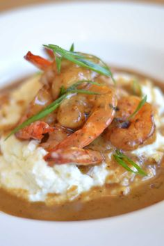 Ralph's on the Park BBQ Shrimp and Grits. My all time favorite Lowcountry and NOLA dish. Cajun Shrimp And Grits, Cajun Shrimp Recipes, Seafood Recipes, Cajun Food, New Orleans Shrimp And Grits Recipe, Seafood Meals, Seafood Dishes, Slow Cooker Pork, Slow Cooker Recipes