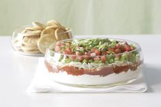 Festive Favorite Layered Dip — Need a dip for a crowd, stat? Six layers of scrumptious, from the creamy base to the fresh-veggie topper, in 10 minutes serves up a tasty solution. Kraft Recipes, Dip Recipes, Cooking Recipes, What's Cooking, Salad Recipes, Recipies, Low Calorie Smoothies, Fruit Smoothies, Appetizer Dips